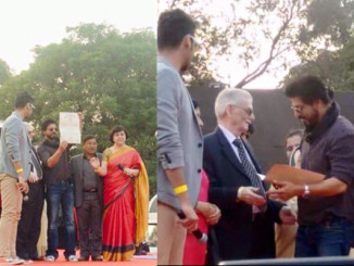 Shah Rukh Khan collects his degree. Image Courtesy: Twitter