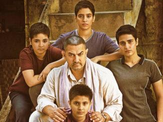Aamir Khan with his onscreen daughters in Dangal