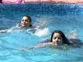 Lopa and Mona enjoy a dip in the pool