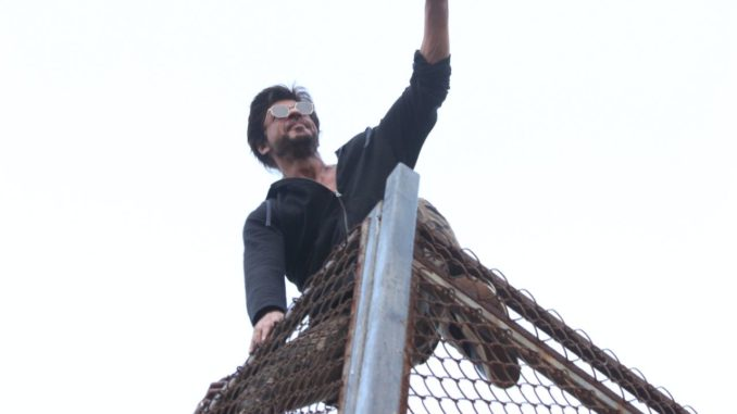 Shah Rukh Khan waves to his fans outside Mannat