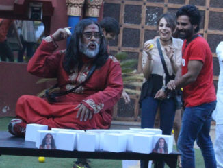 Om Swami parks himself on the table during the captaincy task