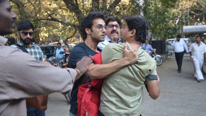 Pulkit Samrat grabs the collar of a photographer
