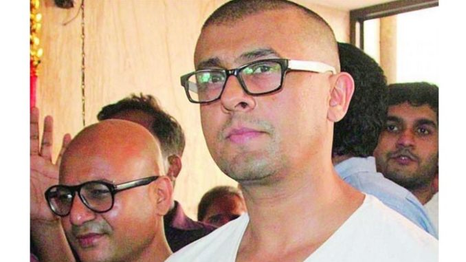 Sonu Nigam after shaving his head. Image Courtesy: Twitter