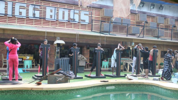 Contestants perform the luxury budget task
