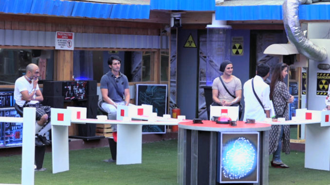 Contestants performing the luxury budget task